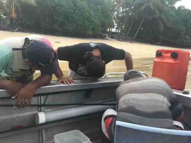 The guys trying to start the boat....