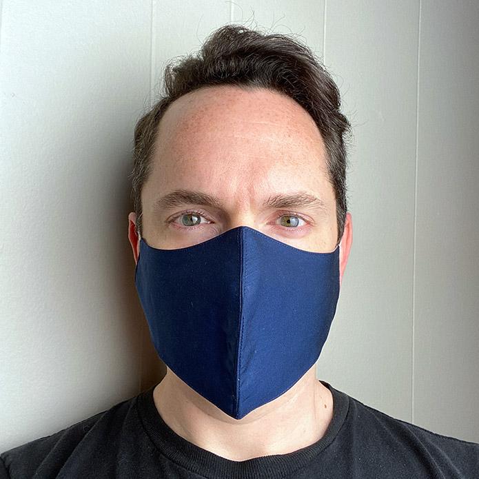 front facing man wearing navy face mask