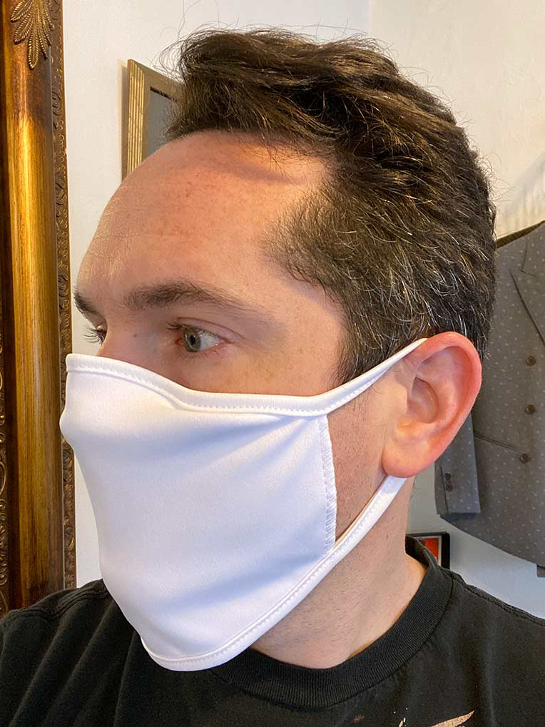 white face mask worn by man with side view