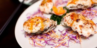 Yaki Kaki, grilled oyster with cheese on top