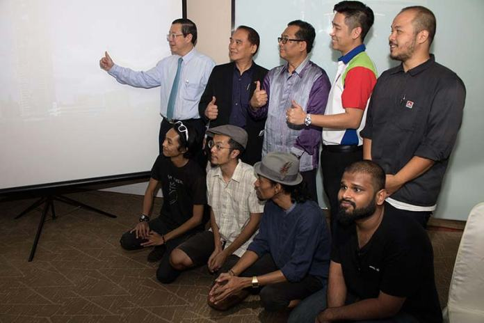 5 local artists will be painting the world's tallest mural on the famous Penang's Komtar tower