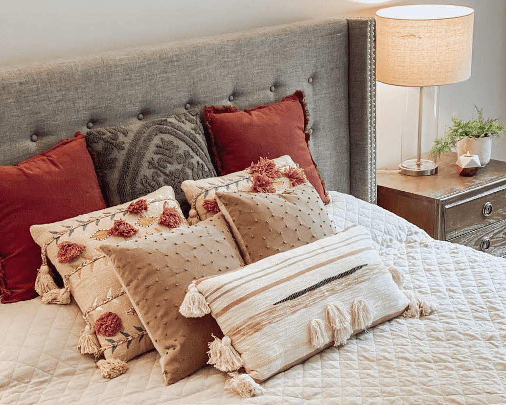 Burgundy and Blush Bedroom Pillows make this bed perfect