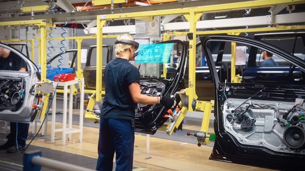 Yes, that's a guy wearing a HoloLens on an assembly line. Don't try this with a VR device!