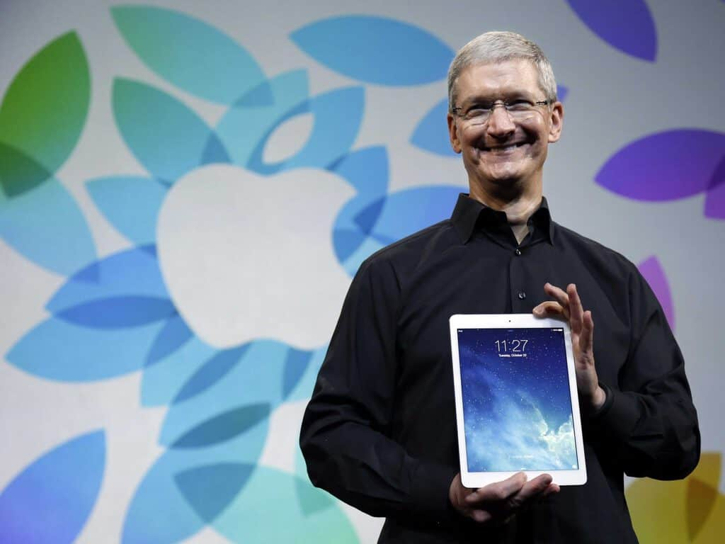 Apple CEO Tim Cook holds an iPad.