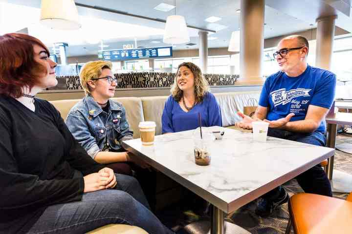 Katie Stone Perez and Chris Charla mentoring two young game developers.