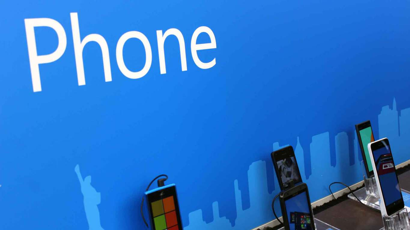 Photo of Windows phones lined up in a Microsoft store