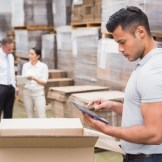 Warehouse-worker-with-Ipad