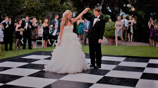First dance on black and white dance floor on lawn