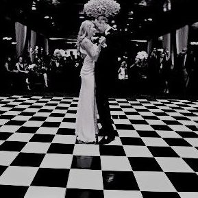 First dance on black and white small checkered dance floor indoors