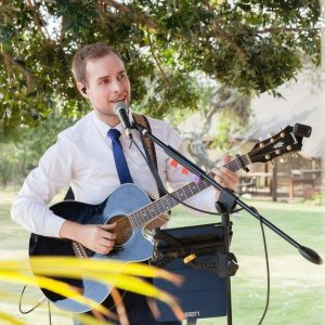 Liam with his acoustic guitar entertaining wedding guests during canapes.