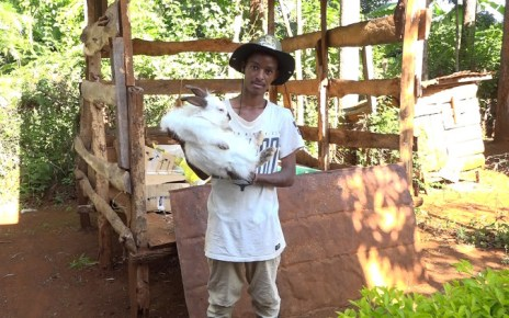 Benjamin Gathii at his rabbit farm