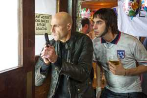 Grimsby-Mark-Strong-Sacha-Baron-Cohen.2