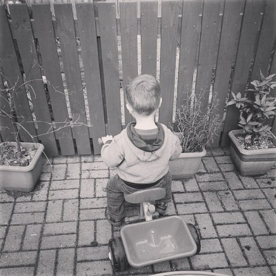 Watching Daddy cleaning his bike up.