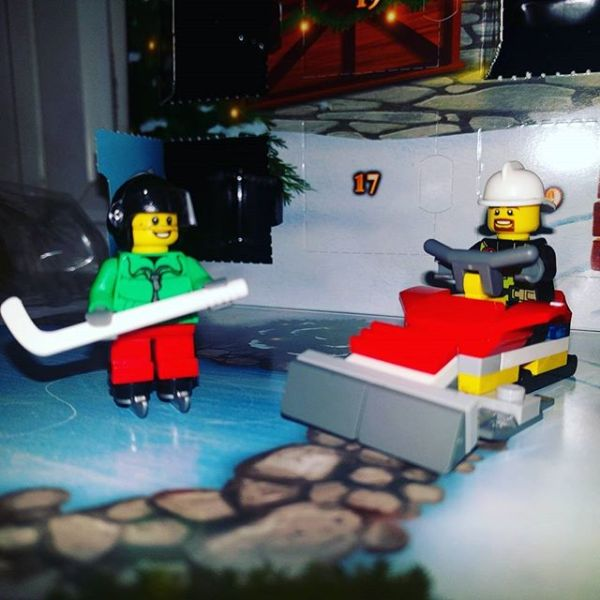 #legocityadvent Day 8: fireboy talking to ice hockey playing Lego man