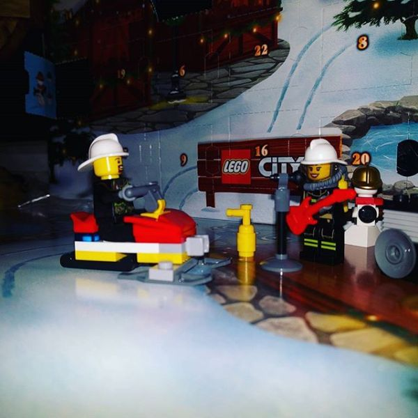 #legocityadvent Day 5: fireman gets a snowmobile which he shows off to rocking firewoman.