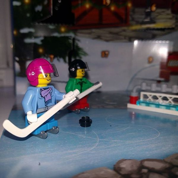 #legocityadvent. Day 10: girl hockey player joining boy hockey player on the ice...