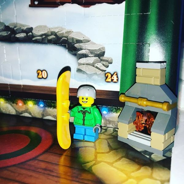 Snowboard boy warming up by the fire in #legocityadvent