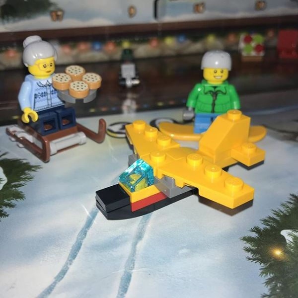 Snowboard boy & pizza Granny admire the latest drone to land in #legocityadvent