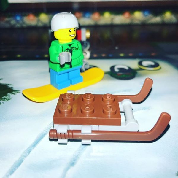 Snowboard boy admiring the new sled in #legocityadvent