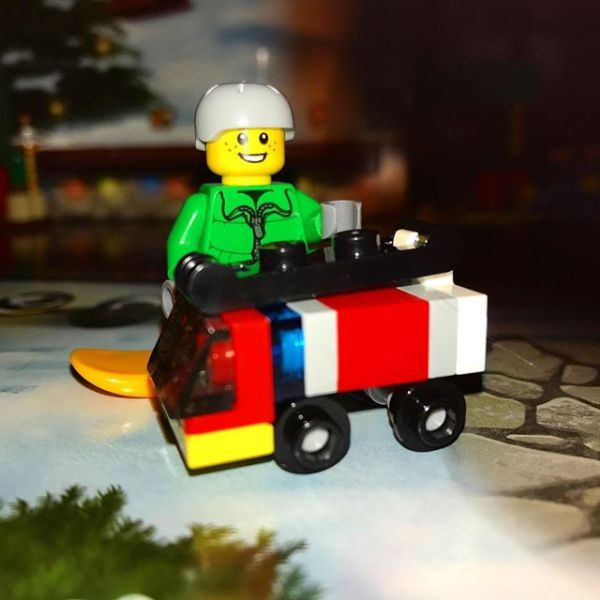 Today snowboard boy is pleased with his toy fire truck in #legocityadvent