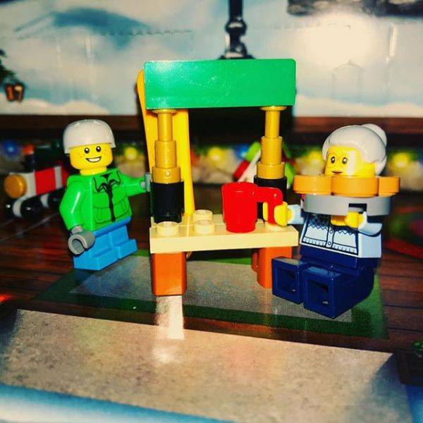 Pizza Granny has definitely decided the mug of festive drink is for her not snowboard boy #legocityadvent