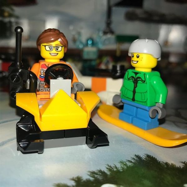 Drone lady now has a powered snowmobile to get around #legocityadvent Snowboard boy is impressed....