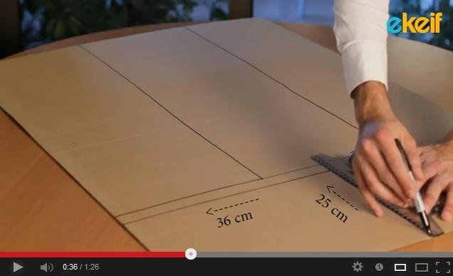 فيديو: كيف نصنع الة لطي الملابس