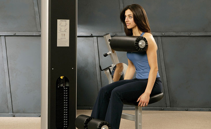Woman Using Front Loaded Ab Crunch Machine