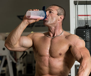 Fit Muscleman Drinking BCAA Protein