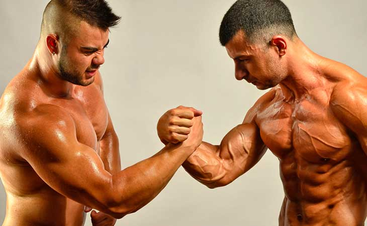 Two Bodybuilders Comparing Stregth