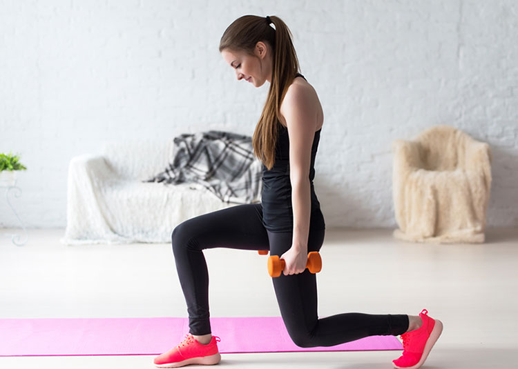 Woman Using Hand Weights For Fitness
