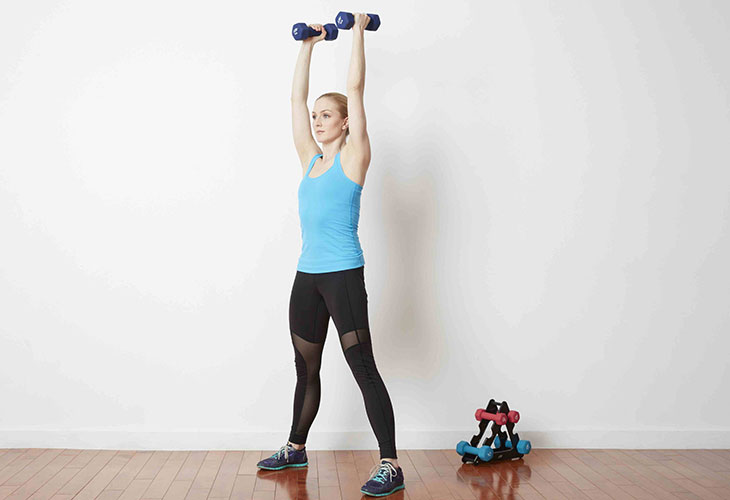 Woman Working Out Dumbbell Clean and Press