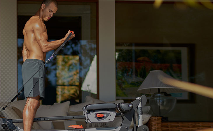 Man Working Out Using Bowflex Revolution Home Gym
