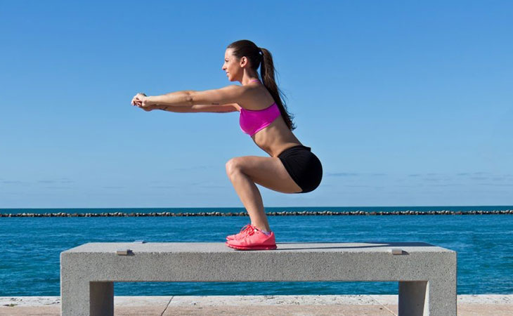 Woman Squatting For Fitness