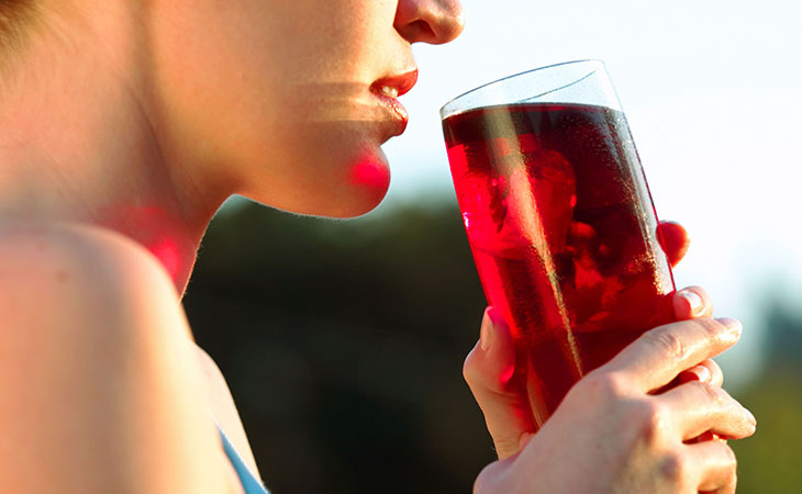 Woman Drinking Healthy Cranberry Juice
