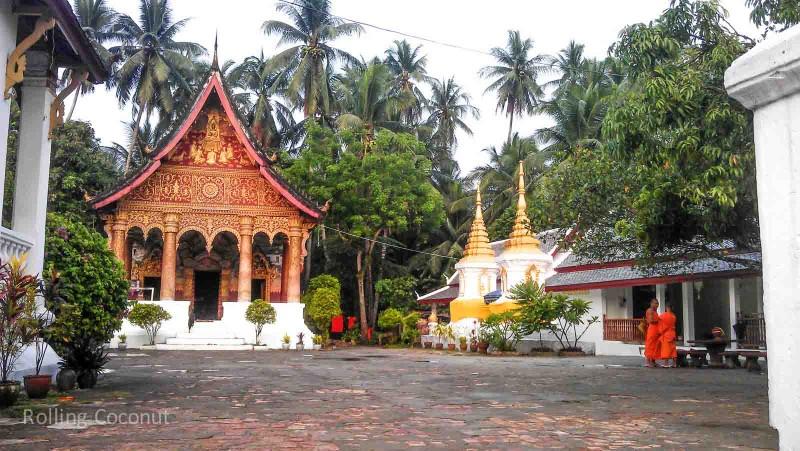Wat Monks Vientiane Laos Rolling Coconut Photo Ooaworld