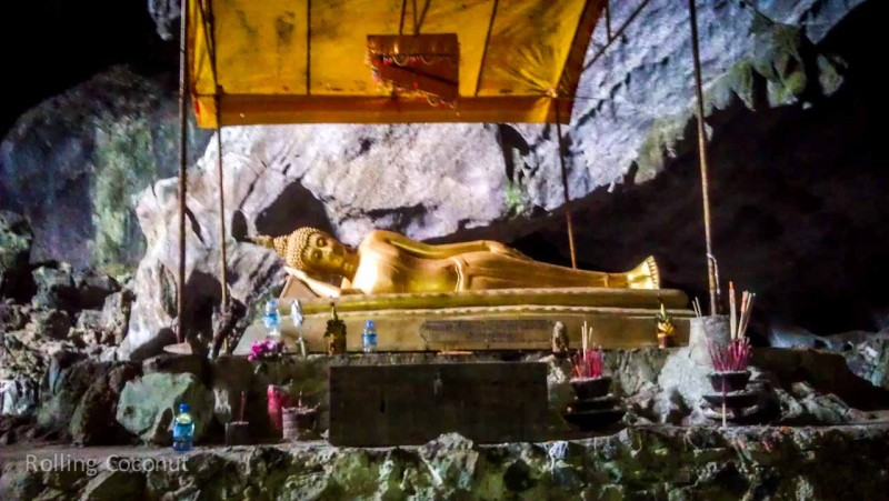 Sleeping Buddha inside Golden Cave in Vang Vieng Laos Photo Ooaworld