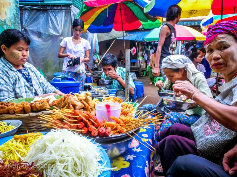 Breakfast with the locals in Hpa An market Myanmar ooaworld Rolling Coconut Photo Ooaworld