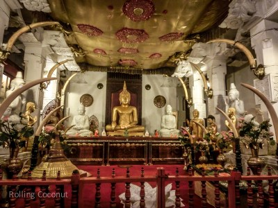 Kandy Temple of the Tooth Buddha Statue Sri Lanka ooaworld Rolling Coconut Photo Ooaworld