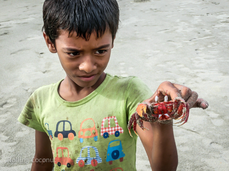 Bangladesh Cox's Bazar Inani Beach Digging for Crabs ooaworld Rolling Coconut Photo Ooaworld