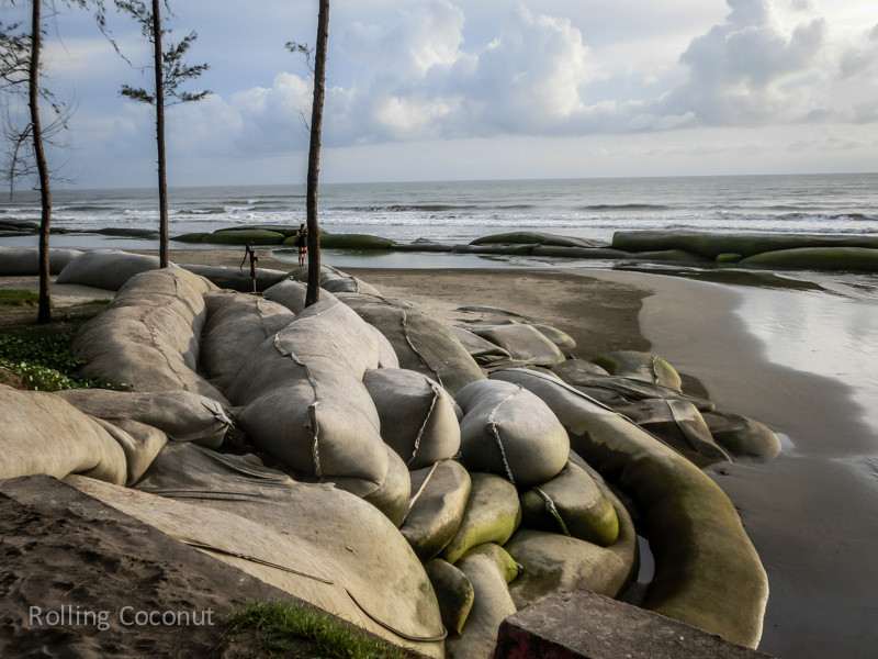 Bangladesh Cox's Bazar Inani Beach Sandbags Protection ooaworld Rolling Coconut Photo Ooaworld
