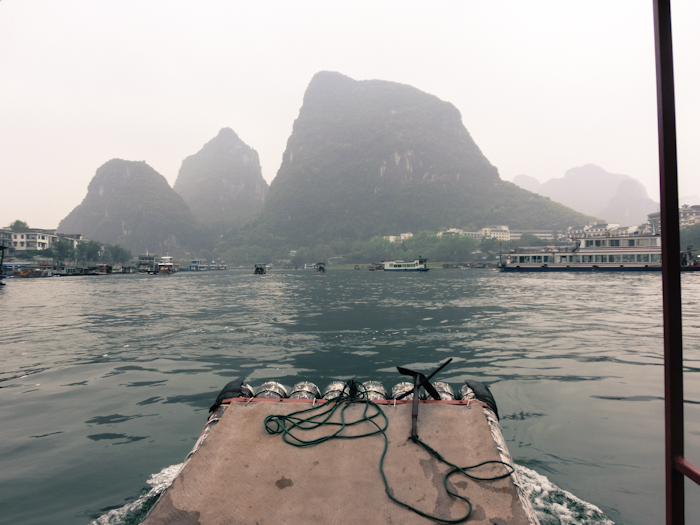 boat tour yangshuo china photo ooaworld Rolling Coconut