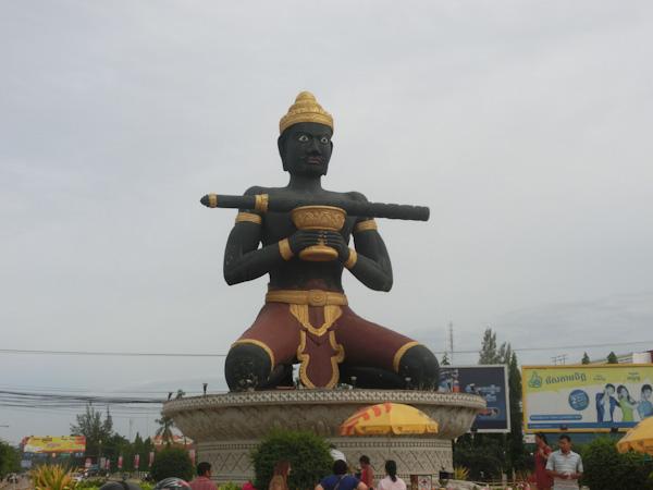 stick-wielding statue battambang cambodia photo ooaworld Rolling Coconut
