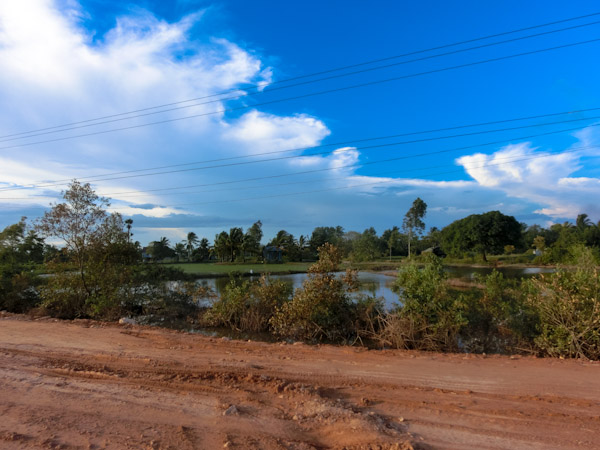 Kampot Kep road cambodia photo ooaworld Rolling Coconut