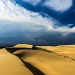 Mui ne white sands dune vietnam photo ooaworld Rolling Coconut