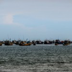 fishing boats mui ne vietnam photo ooaworld Rolling Coconut