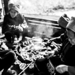 Women cook and chat by the fire in Longsheng