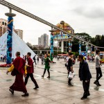 Buddhist monks walk in front of Shenzhen's Window of the World theme park.