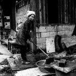Longsheng China, a tribal woman cleans her home
