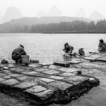 Families gather along the river to wash their laundry in Yangshuo